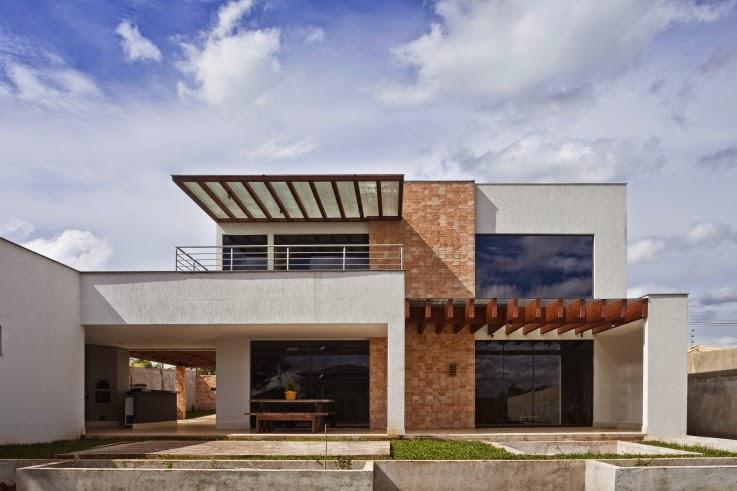 Fachadas para casas em l como escolher for Casa moderna l